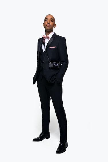 Atiba Jefferson in black tuxedo and camera