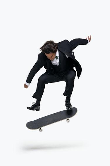 Paul Rodriguez kick flip in Black Tuxedo