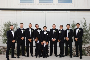 Groom and Groomsmen in Generation Tux Blue Tuxedo