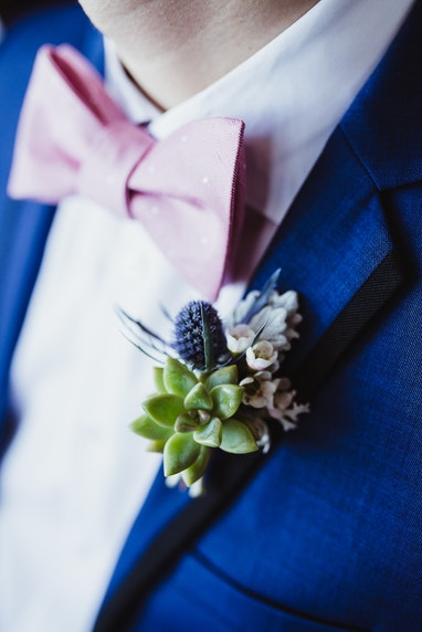 Blue Tuxedo with pink bowtie and Boutonnière
