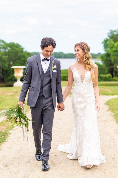Groom in dark grey tuxedo with Bride on Wedding