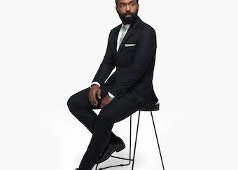 Generation Tux model in black wedding suit