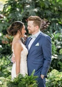 Bride and groom in navy blue suit outdoor wedding
