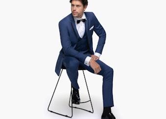 Generation tux model in blue tuxedo wedding rental