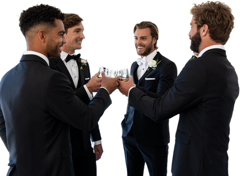 Groomsmen in black tuxedos toasting.