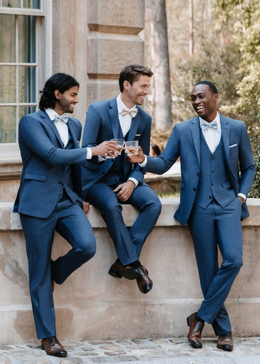 Groomsmen in Allure Dark Blue Suit toasting