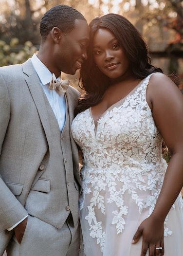 Groom in Allure Light Gray Suit with bride
