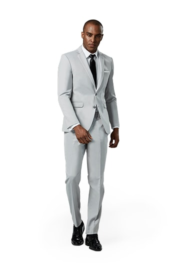 Image of a cement gray notch lapel suit worn in front of a grey background.