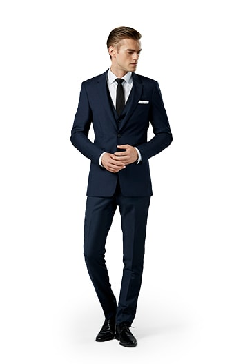 Navy blue notch lapel suit worn in front of a gray background.