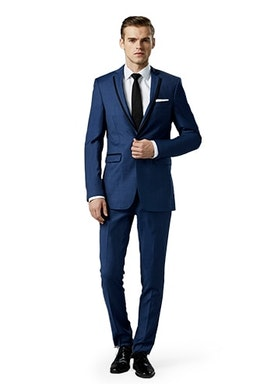 Mystic Blue Notch Lapel suit worn in front of a gray background.