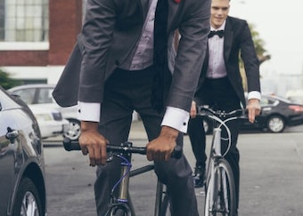 guys in generations tux suits and tuxedos riding bikes